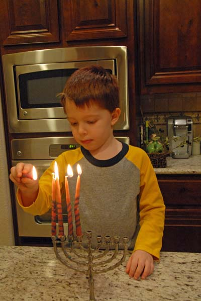 Zach lights the fourth candle.